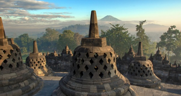 Indonesia - Borobudur, with the Mount Merapi volcano in the background.