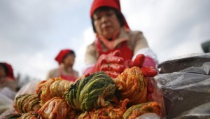 Making traditional Korean side dish kimchi in Seoul. Image: Corbis