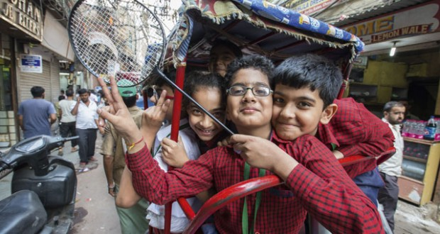 Kids riding in a tuk-tuk through Chandni Chowk neighbourhood, Delhi. Image: Daniel Allen
