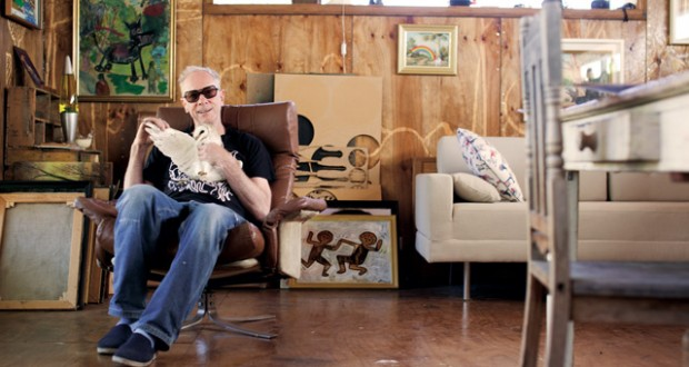 Artist Driller in his studio with his pet barn owl. Image: Newstyle Media