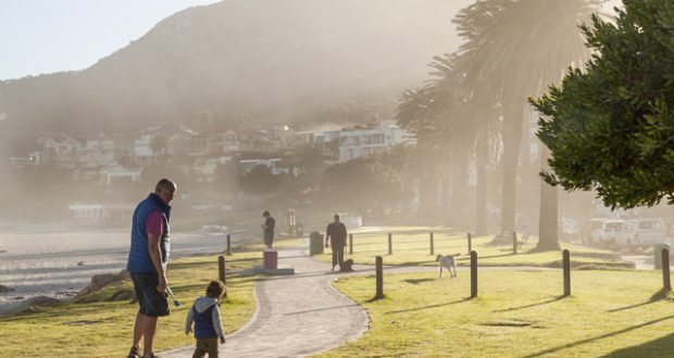 Sunrise strolls on Camps Bay promenade. Image: Alyson Smith