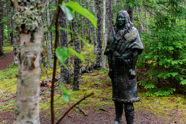 A life-size bronze of a Beothuk woman 'walks' through the forest. This is Shanawdithit, the last survivor and chronicler of the indigenous Beothuk people