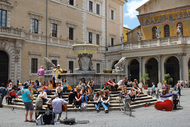 People outside the Basilica, Santa Maria, Trastevere. Image: Alamy