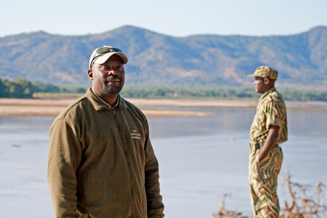Zambia Safari: Manda Chisanga of The Bushcamp Company beside the Luangwa River, overlooking the Chindeni Hills, South Luangwa National Park