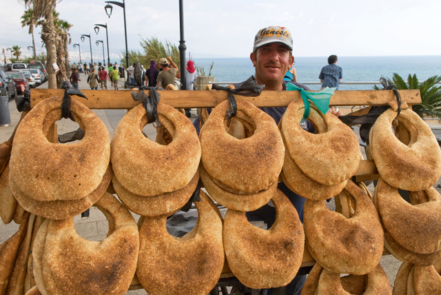 Street vendor selling ka'ik (bread with sesame seeds) along the Corniche. Image: Alamy