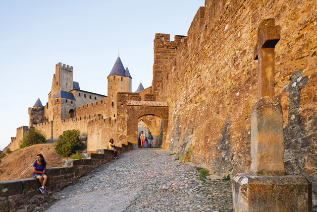 Carcassonne's swashbuckling good looks are partly the result of a 19th-century restoration that added crenellations, conical towers and arrow slits — evidence that in Occitania, initial appearances can hide a deeper story. Credit: Alamy