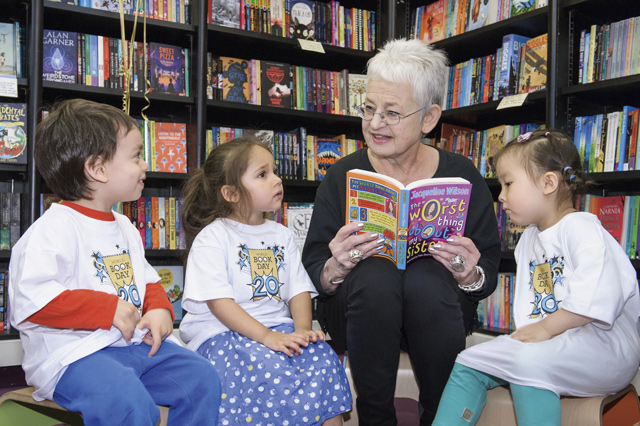Jacqueline Wilson reads to children. Credit: World Book Day
