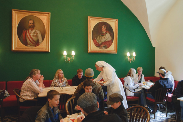 Nuns and visitors eatings at the Austrian Hopsice of the Holy Family. Credit: Noam Chen, Israeli Ministry of Tourism