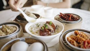 Noodles and a variety of dim sum. Image: Getty