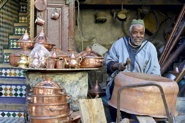 Hamid Filali, a coppersmith at work in the Medina of Fez. Image: Pól Ó Conghaile