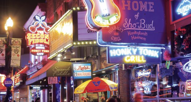 Night lights of Broadway in downtown Nashville. Image: Getty
