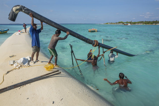 A 'geo-tube', when filled with sand, will break wave action in the coming monsoon season. As the lowest country on Earth, the Maldives is at risk from rising sea levels and efforts to keep it at bay are relentless. Credit: Getty